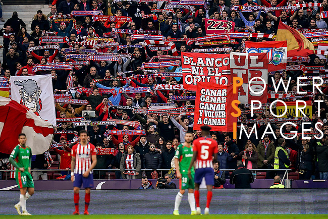 Soccer fans of Atletico de Madrid wave banners to show the supports to their team during the La Liga 2018-19 match between Atletico de Madrid and Deportivo Alaves at Wanda Metropolitano on December 08 2018 in Madrid, Spain. Photo by Diego Souto / Power Sport Images