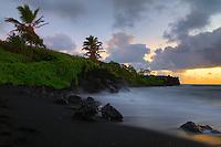 Sunrise at Waianapanapa black sand beach in Hana