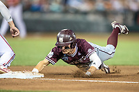 Mississippi State Bulldogs outfielder Jake Mangum (15) dives back to first base during Game 10 of the NCAA College World Series against the Louisville Cardinals on June 20, 2019 at TD Ameritrade Park in Omaha, Nebraska. Louisville defeated Mississippi State 4-3. (Andrew Woolley/Four Seam Images)