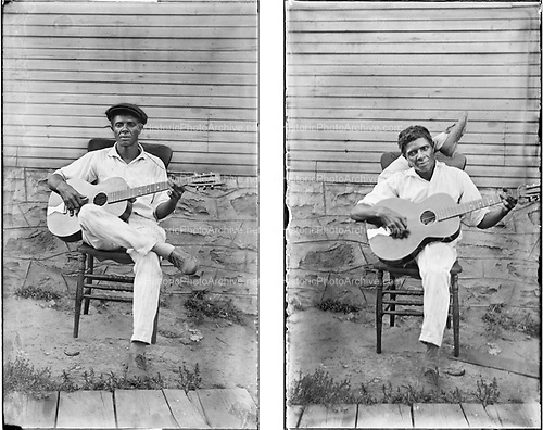 0102-03. Black contortionist playing guitar, Image was taken ca. 1915-1926 in the area of Coral, Blacklick and Josephine in Western Pennsylvania,just east of Blairsville on route 119 north.