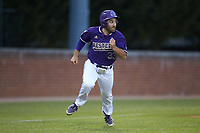 Seth Graves (33) of the Western Carolina Catamounts hustles towards home plate against the St. John's Red Storm at Childress Field on March 12, 2021 in Cullowhee, North Carolina. (Brian Westerholt/Four Seam Images)
