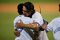 Dunedin Blue Jays Ryan Noda (19) celebrates with Jesus Navarro (10) after hitting a walk off grand slam home run in the bottom of the ninth inning during a Florida State League game against the Jupiter Hammerheads on May 15, 2019 at Jack Russell Memorial Stadium in Clearwater, Florida.  Dunedin defeated Jupiter 8-4 in nine innings, the second game of a doubleheader.  (Mike Janes/Four Seam Images)