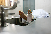 The body of Italian citizen Cesare Tavella, 50, who was gunned down by unidentified assailants on last Monday is kept at a hospital morgue in Dhaka, Bangladesh, Sept. 29, 2015. The Islamic State militant group claimed responsibility for gunning down the Italian citizen on the street in the diplomatic quarter of Bangladesh's capital Dhaka, according to an intelligence group monitoring jihadist threats.
