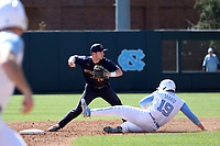 CHAPEL HILL, NC - MARCH 08: Zack Prajzner #14 of the University of Notre Dame makes a throw to first base after forcing out Aaron Sabato #19 of the University of North Carolina during a game between Notre Dame and North Carolina at Boshamer Stadium on March 08, 2020 in Chapel Hill, North Carolina.