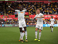 (L-R) Tammy Abraham of Swansea City celebrates his equaliser with team mate Alfie Mawson during the Premier League match between Swansea City and Watford at The Liberty Stadium, Swansea, Wales, UK. Saturday 23 September 2017