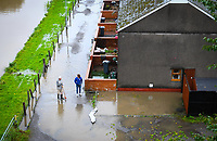 Flooding effected the villages of Aberdulais and Tonna in the Neath Valley after Storm Callum brought heavy rain and wind to the area causing the River Neath to reach bursting point.<br /> Pictured are residents of Canal Side who woke to find their properties and gardens flooded. Saturday 13 October 2018
