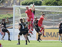 Abby Wambach (20) heads the ball past FC Gold Pride's Nicole Barnhart to score her first goal of the game. Washington Freedom 4-3 over FC Gold Pride in Santa Clara, California, April 26, 2009.