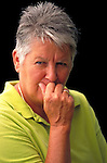 portrait of frowning, concerned elder woman