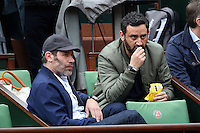 Jalil Lespert and Cyril Hanouna watching tennis during Roland Garros tennis open 2016 on may 29 2016.