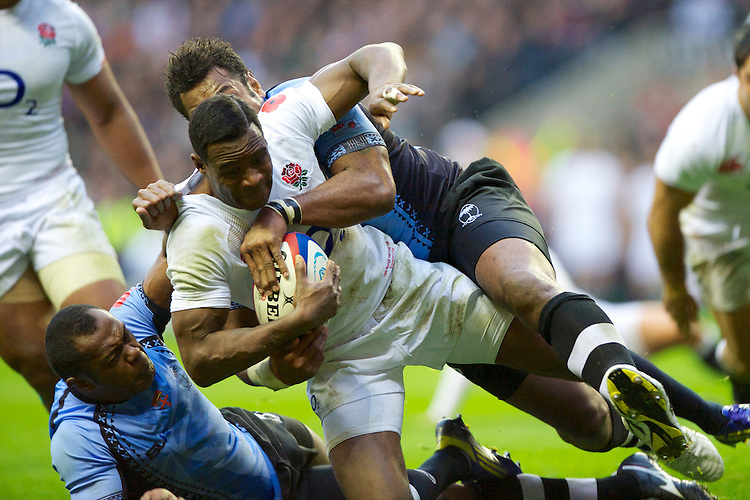 Ugo Monye of England is tackled just short of the line by Vereniki Goneva of the Flying Fijians during the QBE International between England and Fiji at Twickenham on Saturday 10th November 2012 (Photo by Rob Munro)