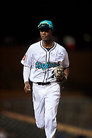 Salt River Rafters shortstop Geraldo Perdomo (7), of the Arizona Diamondbacks organization, jogs off the field between innings of an Arizona Fall League game against the Mesa Solar Sox on September 19, 2019 at Salt River Fields at Talking Stick in Scottsdale, Arizona. Salt River defeated Mesa 4-1. (Zachary Lucy/Four Seam Images)