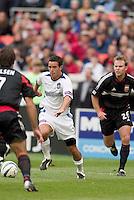 San Jose Earthquakes' Ian Russell faces D.C. United's Ryan Nelsen as Bryan Namoff trails. DC United defeated the San Jose Earthquakes 2 to 1 during the MLS season opener at RFK Stadium, Washington, DC, on April 3, 2004.