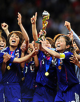 Players of team Japan celebrate during the FIFA Women's World Cup Final USA against Japan at the FIFA Stadium in Frankfurt, Germany on July 17th, 2011.