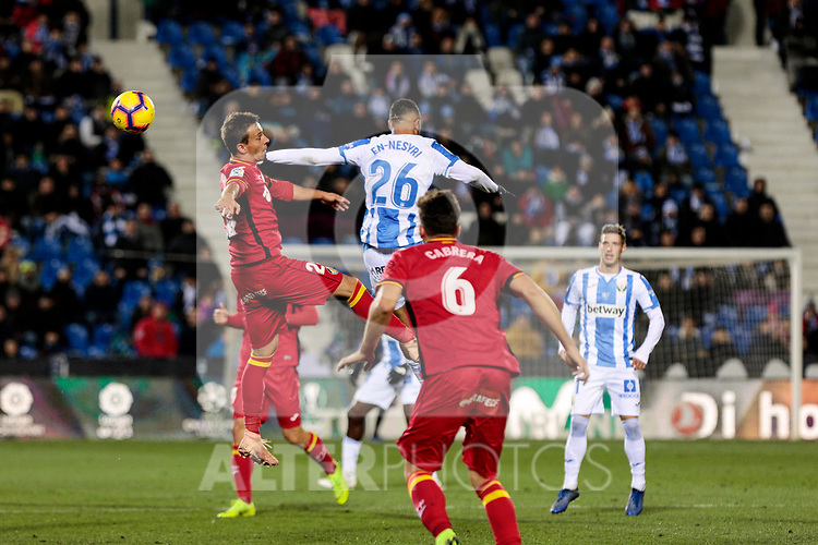 CD Leganes' Youssef En-Nesyri and Getafe CF's Ivan Alejo fight for the ball during La Liga match between CD Leganes and Getafe CF at Butarque Stadium in Leganes, Spain. December 07, 2018. (ALTERPHOTOS/A. Perez Meca)