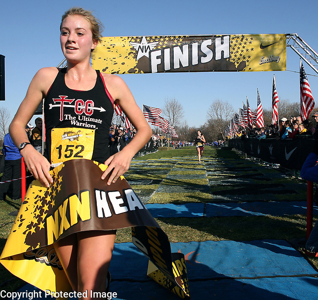 Katie Flood of Dowling Catholic High School in Des Moines, IA wins the Girls Nike Heartland Cross Country Championship Saturday afternoon at Yankton Trail. (Photo by Dave Eggen/Inertia)