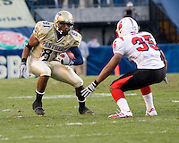 Pitt wide receiver Derek Kinder (81) tries to escape the tackle of Louisville safety Brandon Sharp (35).  The Louisville Cardinals defeated the Pitt Panthers 48-24 on November 25, 2006 at Heinz Field, Pittsburgh, Pennsylvania.