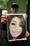 © Joel Goodman - 07973 332324 . . 12/06/2016 . Manchester , UK . A GMP officer holds up a photograph of 26 year old Rebecca Dacre from Ulverston who has gone missing after attending the Parklife festival yesterday (Saturday 11th June 2016) . Parklife music festival at Heaton Park in Manchester . Photo credit : Joel Goodman