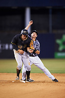 Tampa Yankees second baseman Nick Solak (39) throws to first base as Casey Hughston (17) slides into second during a game against the Bradenton Marauders on April 15, 2017 at George M. Steinbrenner Field in Tampa, Florida.  Obstruction was called against Hughston on the play.   Tampa defeated Bradenton 3-2.  (Mike Janes/Four Seam Images)