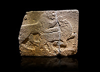 Hittite monumental relief sculpted orthostat stone panel of a Procession. Basalt, Karkamıs, (Kargamıs), Carchemish (Karkemish), 900-700 B.C. Anatolian Civilisations Museum, Ankara, Turkey.<br /> <br /> Two animals struggling with each other. The lion attacking the bull holds the bull's chin and turns it backwards.  <br /> <br /> Against a black background.