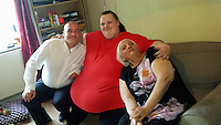 Pictured: Georgia Davis (C) with her mum Lesley (R) and unknown man.<br /> Re: A woman once dubbed Britain's fattest teen has split up from her boyfriend Matthew Takel.<br /> Georgia Davis made headlines when she had to be moved out of her house in Aberdare, south Wales, with the help of the emergency services.