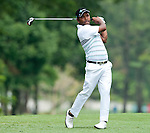 Siddikur in action on the fourth green during Round 1 of the CIMB Asia Pacific Classic 2011.  Photo © Andy Jones / PSI for Carbon Worldwide