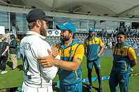 Team captains Kane Williamson (left, NZ) and Mohammad Rizwan chat after day four of the second International Test Cricket match between the New Zealand Black Caps and Pakistan at Hagley Oval in Christchurch, New Zealand on Wednesday, 6 January 2021. Photo: Dave Lintott / lintottphoto.co.nz