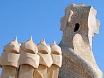 Abstract chimneys atop Antonia Gaudi's La Pedrera in Barcelona, Spain.  Built in 1906-1910.