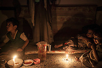 July 03, 2015 - Sana'a, Yemen: Faud Hassan (centre left) 38 years-old, shares Iftar with three of his children in a classroom used as temporary shelter for IDP's in Al Quds school in Sana'a. (Photo/Narciso Contreras)