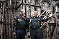 Quebec premier Philippe Couillard, left, looks around as Konrad Sioui, Grand Chef of the Huron-Wendat nation, gestures during a visit of the Longhouse at the Hotel-Musee in Wendake, a Huron reserve enclave within Quebec City, Thursday July 17, 2014.<br /> <br /> PHOTO :  Francis Vachon - Agence Quebec Presse