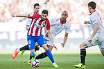 Yannick Ferreira Carrasco (l) of Atletico de Madrid competes for the ball with Steven N'Kemboanza Mike N'Zonzi (r) of Sevilla FC during their La Liga match between Atletico de Madrid and Sevilla FC at the Estadio Vicente Calderon on 19 March 2017 in Madrid, Spain. Photo by Diego Gonzalez Souto / Power Sport Images