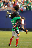 Mexico (MEX) goalkeeper Guillermo Ochoa (1) jumps into the arms of Jonny Magallon (2) at the final whistle. Mexico (MEX) defeated the United States (USA) 5-0 during the finals of the CONCACAF Gold Cup at Giants Stadium in East Rutherford, NJ, on July 26, 2009.