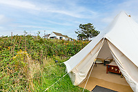BNPS.co.uk (01202 558833)<br /> Pic: LillicrapChilcott/BNPS<br /> <br /> Pictured: A glamping tent beside the house.<br /> <br /> Homebuyers can get the best of coast and country with this spectacular house on the market for offers in excess of £1.5m.<br /> <br /> Westfield sits in an incredible position with views over its own land and the sea at Trevaunance Cove in Cornwall.<br /> <br /> The four-bedroom family home is on the edge of the sought-after village of St Agnes, popular with locals, second home owners and holidaymakers.<br /> <br /> The hub of the home is the open-plan kitchen/family room with a folding door that opens up to the sea-facing terrace.