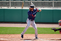 Minnesota Twins Jake Cave (60) bats during a Major League Spring Training game against the Boston Red Sox on March 17, 2021 at JetBlue Park in Fort Myers, Florida.  (Mike Janes/Four Seam Images)