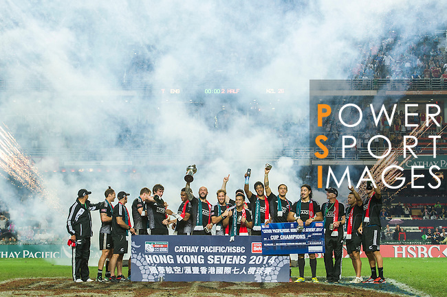 New Zealand players celebrate with the trophy after winning the Cup Final the Cathay Pacific / HSBC Hong Kong Sevens at the Hong Kong Stadium on 30 March 2014 in Hong Kong, China. Photo by Victor Fraile / Power Sport Images