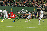 Portland, Oregon - Wednesday September 25, 2019: Andy Polo #11 tries to get around Diego Fagundez #14 during a regular season game between Portland Timbers and New England Revolution at Providence Park on September 25, 2019 in Portland, Oregon.