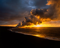 Volcanic gas steam plume backlit at sunrise, Volcanoes National Park, Big Island, Hawaii, USA.