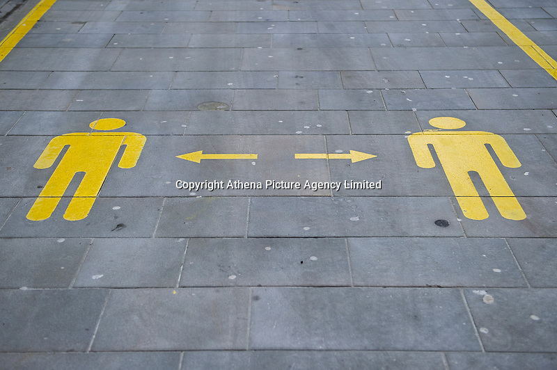 Pictured: Social distancing reminder painted on the floor of Queen Street in Cardiff, Wales, UK. Friday 8th January 2021<br /> Re: The whole of Wales in in Tier 4 due to rising Covid-19 Coronavirus cases, Cardiff, Wales, UK.