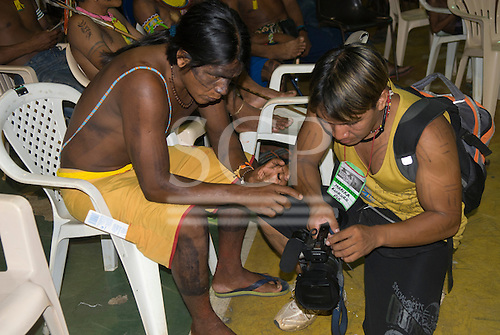 """Altamira, Brazil. """"Xingu Vivo Para Sempre"""" protest meeting about the proposed Belo Monte hydroeletric dam and other dams on the Xingu river and its tributaries. Irekoko Kayapo learning from Marika Kuikuro about video making."""