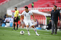 ZAPOPAN, MEXICO - MARCH 21: Sebastian Saucedo #10 of the United States controls the ball during a game between Dominican Republic and USMNT U-23 at Estadio Akron on March 21, 2021 in Zapopan, Mexico.