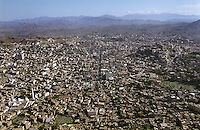 View of Ta'izz, one of the many towns in Yemen which has exploded in size over the past few years as people leave rural areas to seek work in urban centres where unemployment and provision of services is becoming problematic. Government education is generally poor, and the supply of water is becoming a problem in many towns and cities.