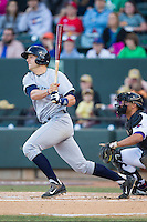 Hunter Dozier (18) of the Wilmington Blue Rocks follows through on his swing against the Winston-Salem Dash at BB&T Ballpark on April 5, 2014 in Winston-Salem, North Carolina.  The Dash defeated the Blue Rocks 3-2.  (Brian Westerholt/Four Seam Images)