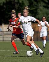 Boston College midfielder Kristen Mewis (19) on the attack as University of Virginia midfielder Morgan Brian (6) closes. Boston College defeated University of Virginia, 2-0, at the Newton Soccer Field, on September 18, 2011.