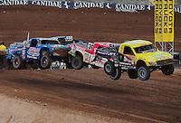 Mar. 20, 2011; Chandler, AZ, USA;  LOORRS pro two driver Rob Naughton (54) leads Rodrigo Ampudia and Robby Woods during round two at Firebird International Raceway. Mandatory Credit: Mark J. Rebilas-