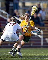 University of Vermont midfielder Karli Mackendrick (11) on the attack. Boston College defeated University of Vermont, 15-9, at Newton Campus Field, April 4, 2012.
