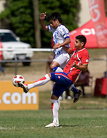 Diego Galdamez (8) of El Salvador has the ball cleared away from him by Gabriel Leiva (10) of Costa Rica during the group stage of the CONCACAF Men's Under 17 Championship at Jarrett Park in Montego Bay, Jamaica. Costa Rica defeated El Salvador, 3-2.