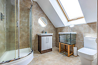 BNPS.co.uk (01202 558833)<br /> Pic: PurpleBricks/BNPS<br /> <br /> Pictured: A bathroom.<br /> <br /> A luxury ten-bedroom eco-home has gone on sale for offers in excess of £850,000 - the same price as a one-bedroom flat in Chelsea.<br /> <br /> The new owner will buy the chance to become an eco-laird, as the property can be run entirely off-grid and includes four lochs and 38 acres of land which could potentially be re-wilded.<br /> <br /> Leadburn Manor at West Linton is just 12 miles south of Edinburgh in Scotland, but looks out over open countryside.