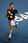 BANGKOK, THAILAND - OCTOBER 01:  Guillermo Garcia-Lopez of Spain returns a ball to Ernets Gulbis of Latvia during the Day 7 of the PTT Thailand Open at Impact Arena on October 1, 2010 in Bangkok, Thailand. Photo by Victor Fraile / The Power of Sport Images