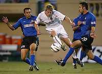 12 June 2004: MetroStars John Wolyniec kicks the ball between Earthquakes Ryan Cochrane and Ramiro Corrales at Spartan Stadium in San Jose, California.    Earthquakes defeated MetroStars, 3-1.   Mandatory Credit: Michael Pimentel / ISI