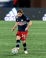 FOXBOROUGH, MA - NOVEMBER 20: Tommy McNamara #26 of New England Revolution passes the ball during the Audi 2020 MLS Cup Playoffs, Eastern Conference Play-In Round game between Montreal Impact and New England Revolution at Gillette Stadium on November 20, 2020 in Foxborough, Massachusetts.