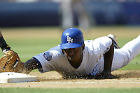 Joe Thurston of the Los Angeles Dodgers slides back to first base during a 2002 MLB season game at Dodger Stadium, in Los Angeles, California. (Larry Goren/Four Seam Images)